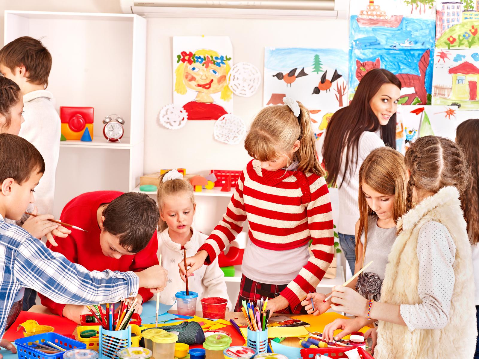 bigstock-Child-painting-at-art-school--39175162